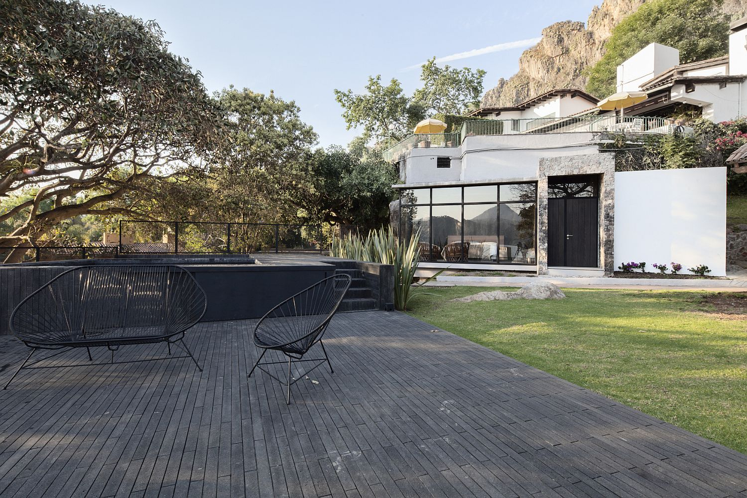 Wooden deck outside the house becomes one with the landscape