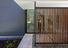 Wooden-slats-and-glass-combine-privacy-with-the-right-natural-lighting-217x155