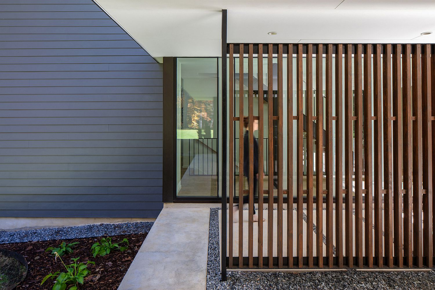 Wooden slats and glass combine privacy with the right natural lighting