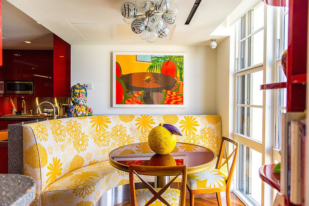 Yellow banquet style seating steals the show in this tropical style dining room