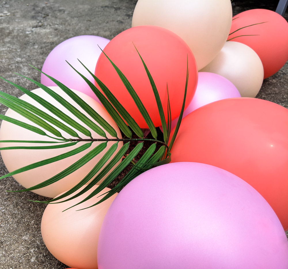 Add palm leaves to your balloon arch