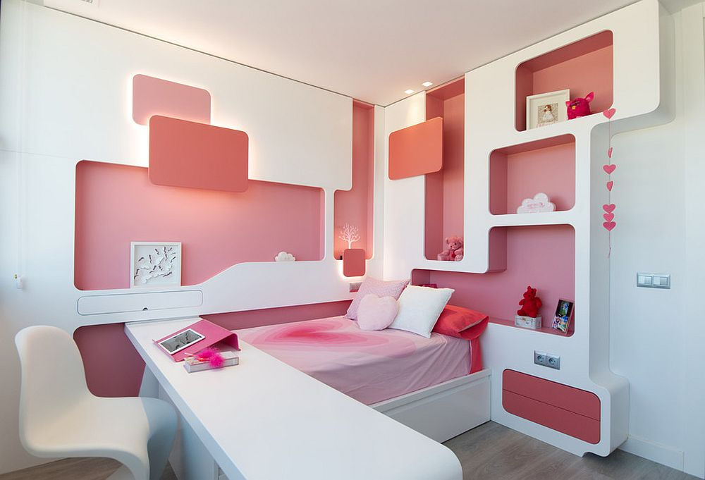 Awesome pink and white small kids' room with space-savvy shelving