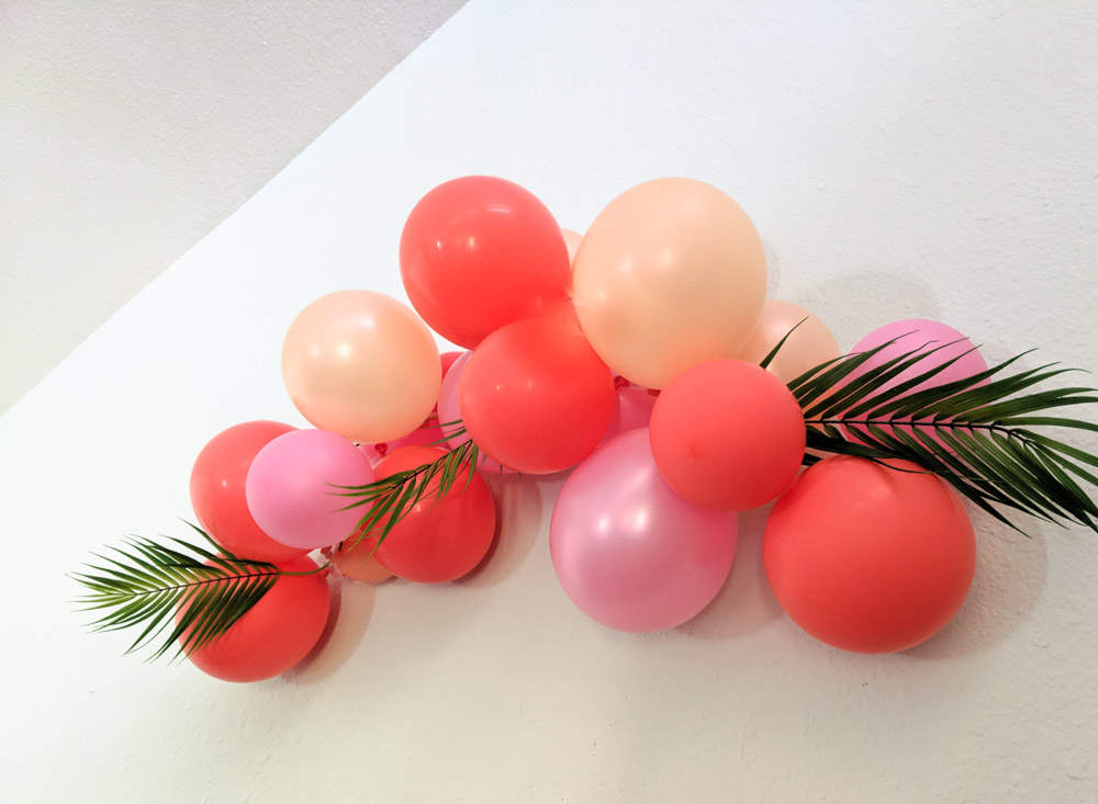 Balloon arch with peach, pink and coral balloons