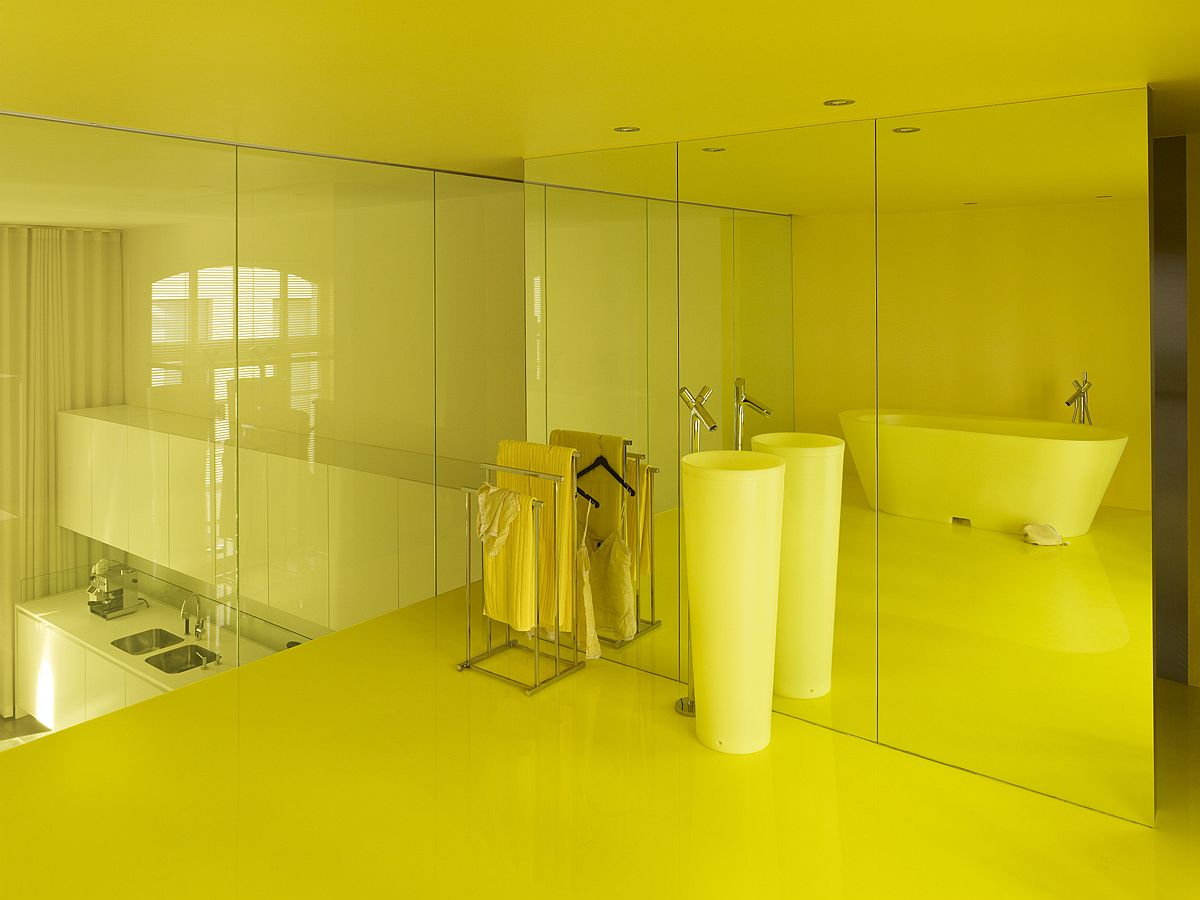 Bathroom with yellow floor, ceiling and plenty of natural light
