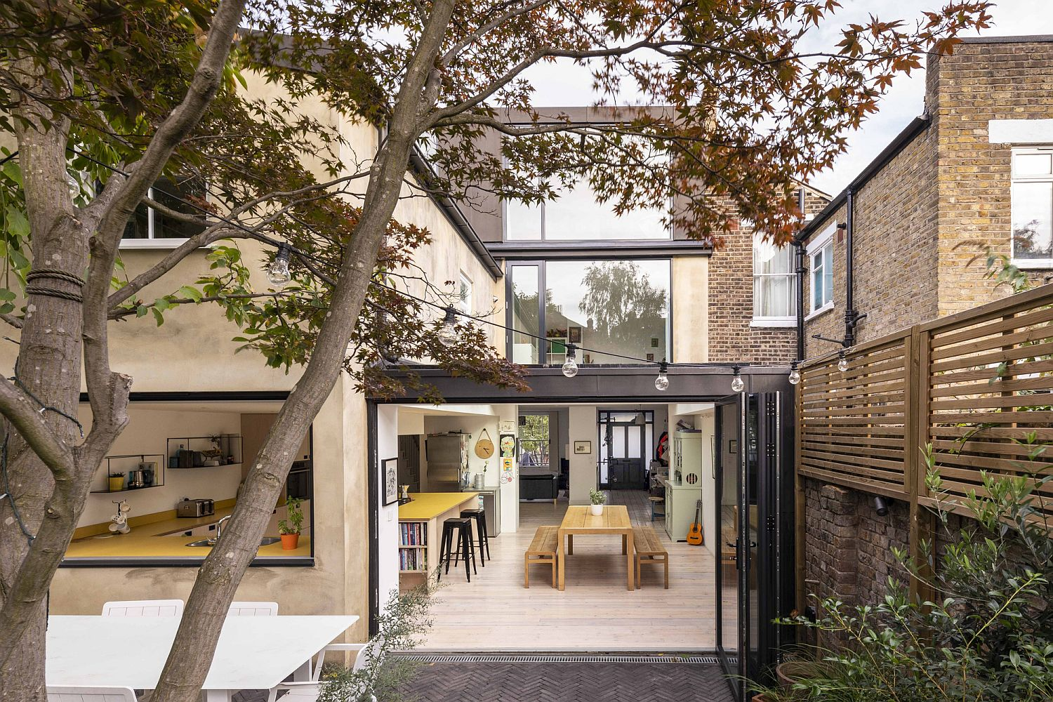 Beautifully revamped coach house in UK with a contemporary kitchen and dining space