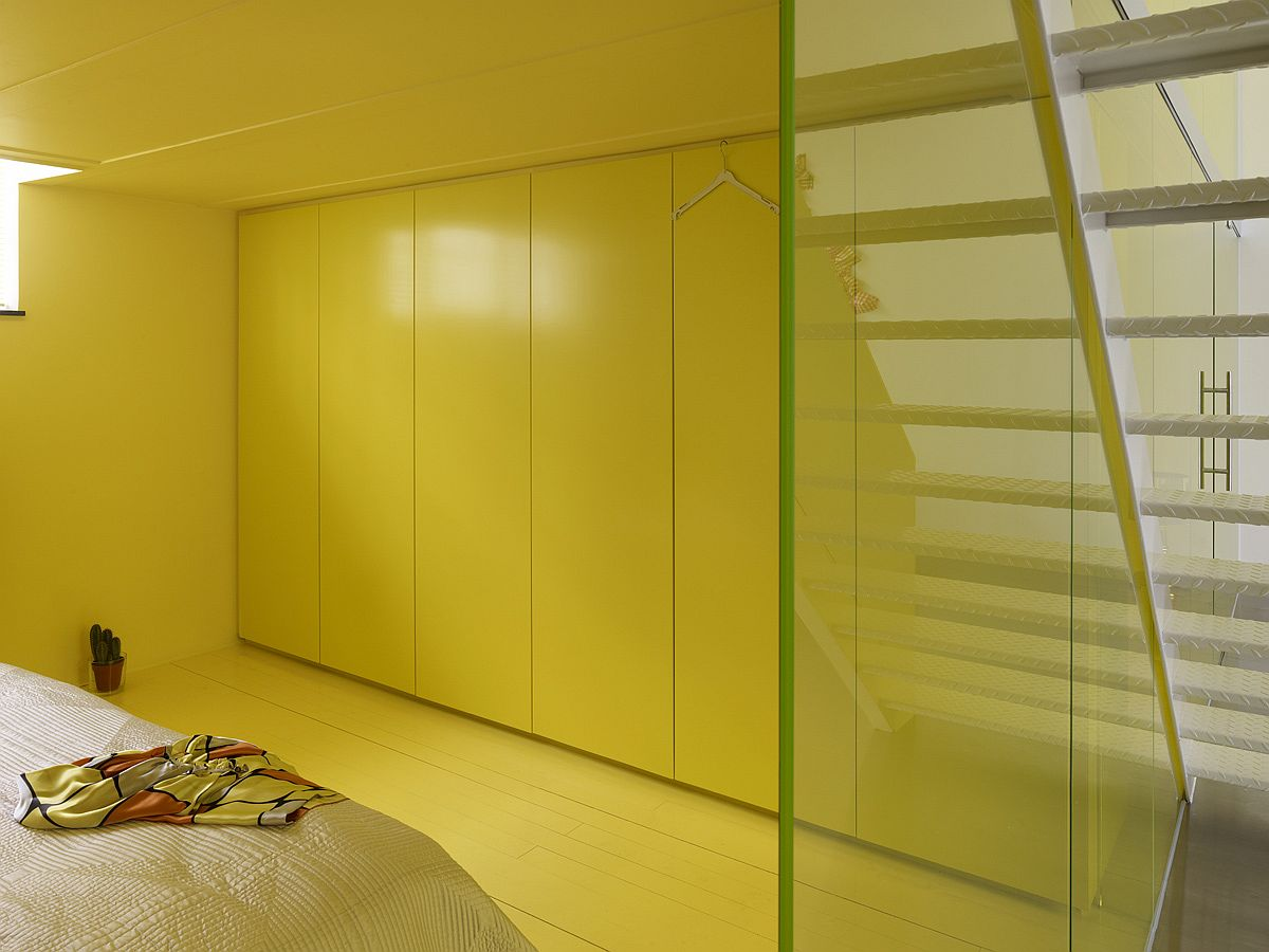 Bedroom with yellow haze adds to the unique appeal of the loft