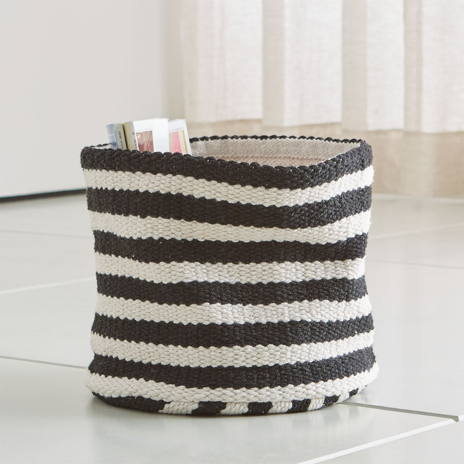 Black and white striped woven basket