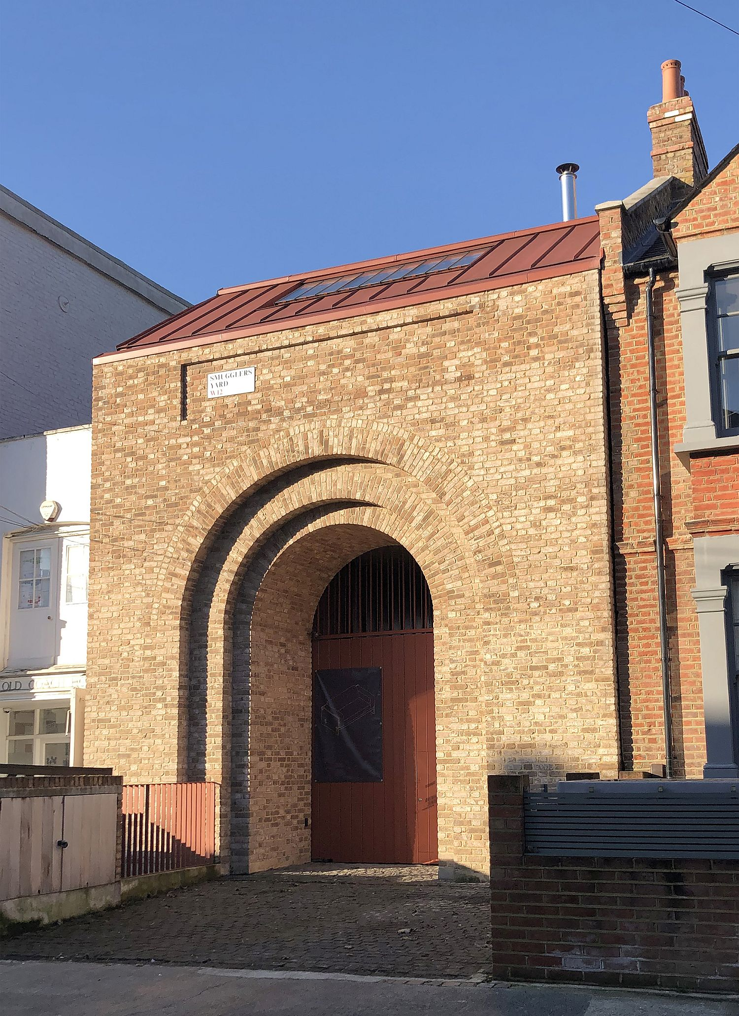 Brick archway welcomes you at this gorgeous British home