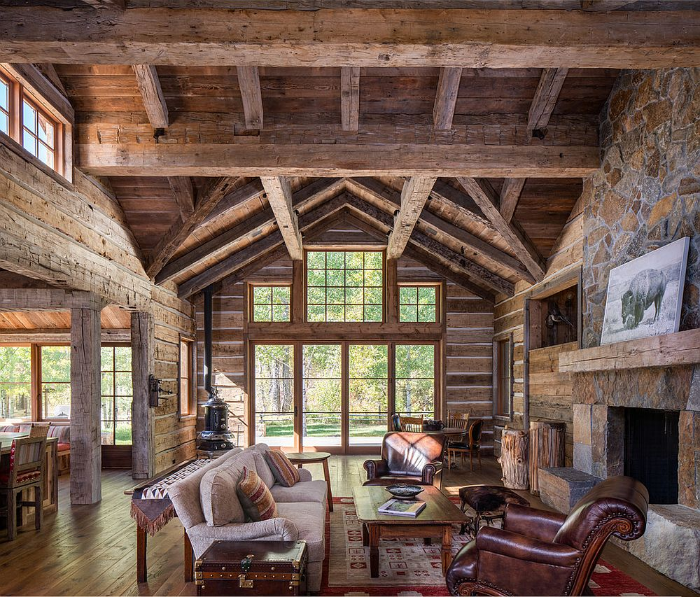 Cabin-style rustic living room in wood and stone