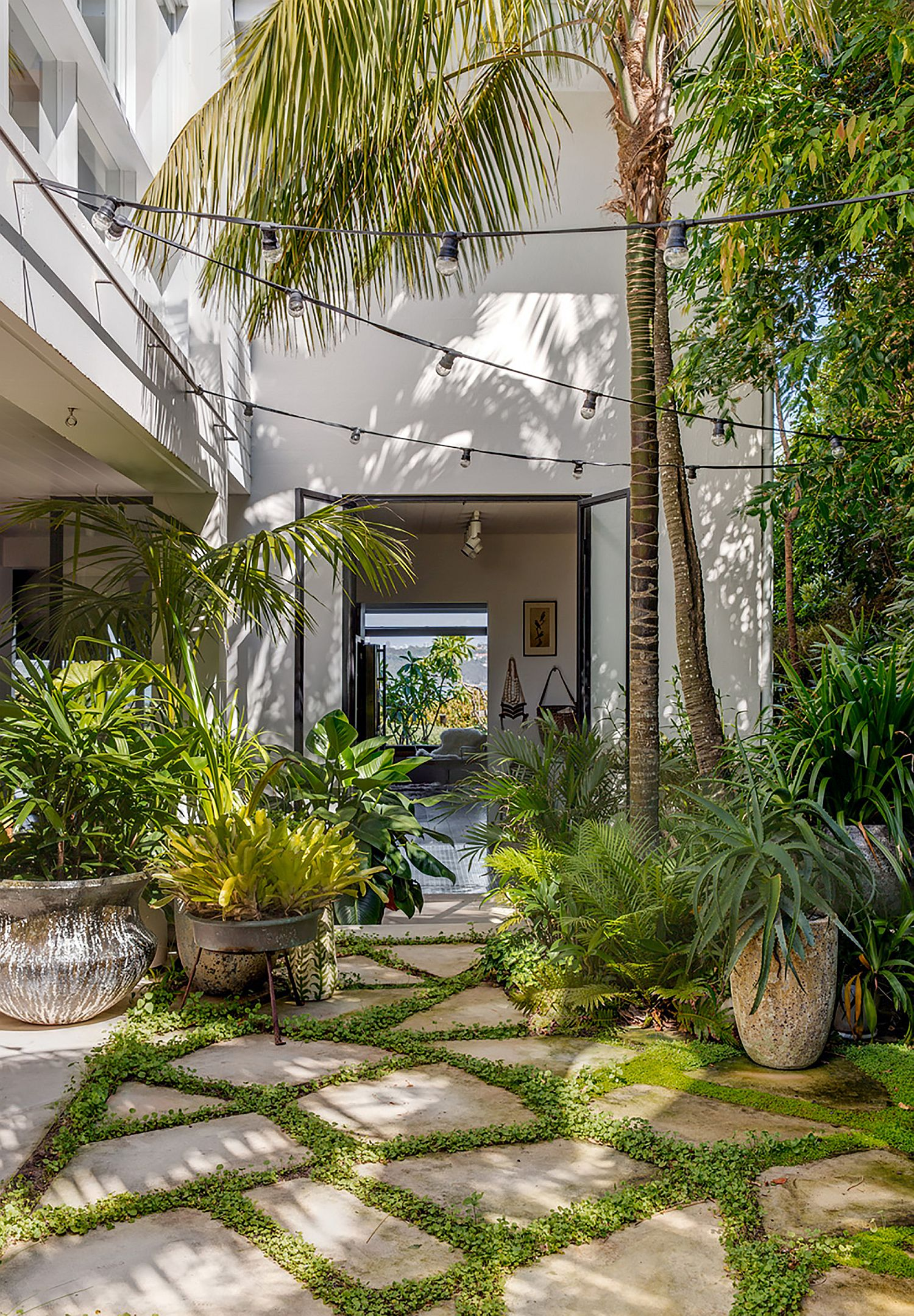 Curated landscape around the house promotes outdoor living