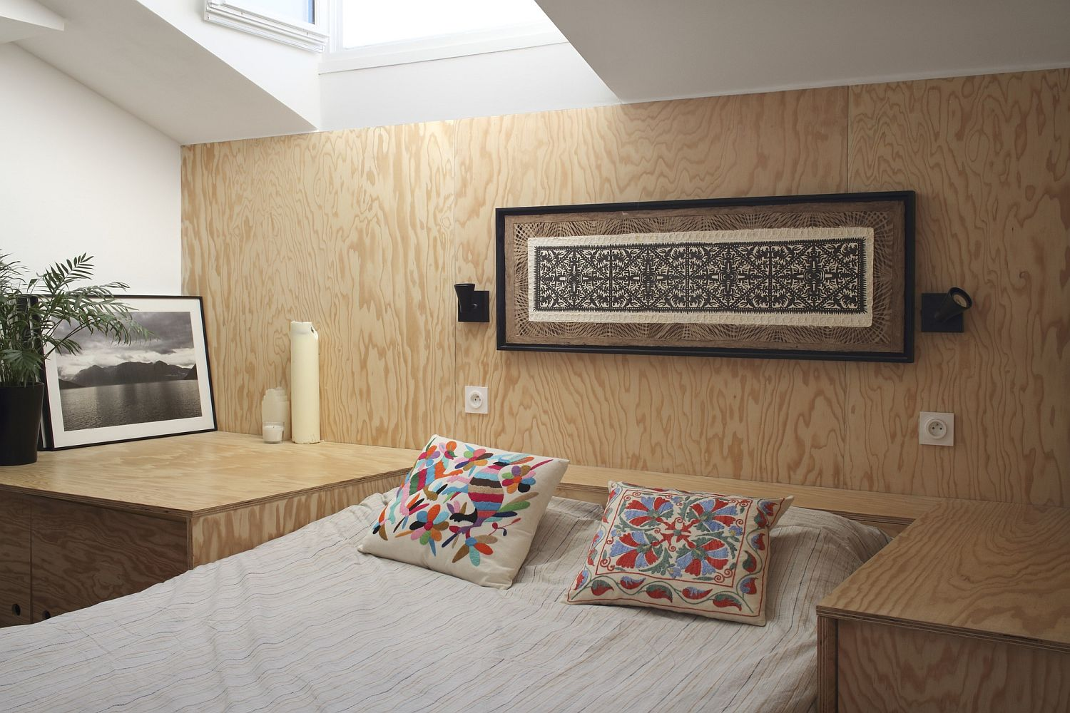 Custom wooden platform morphs to create different decor pieces throughout the house