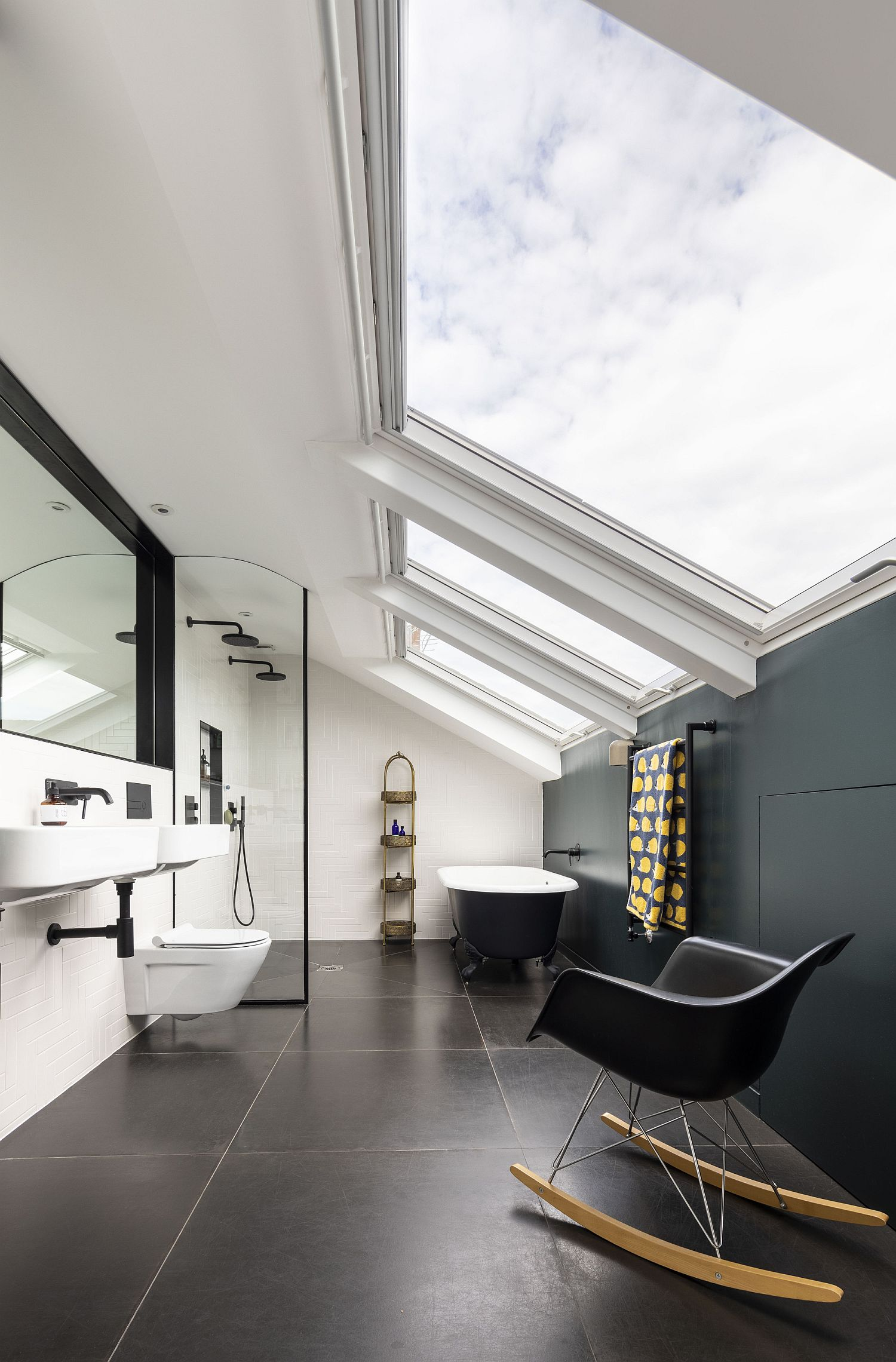 Dashing bathroom in black and white with skylights that make a big impact