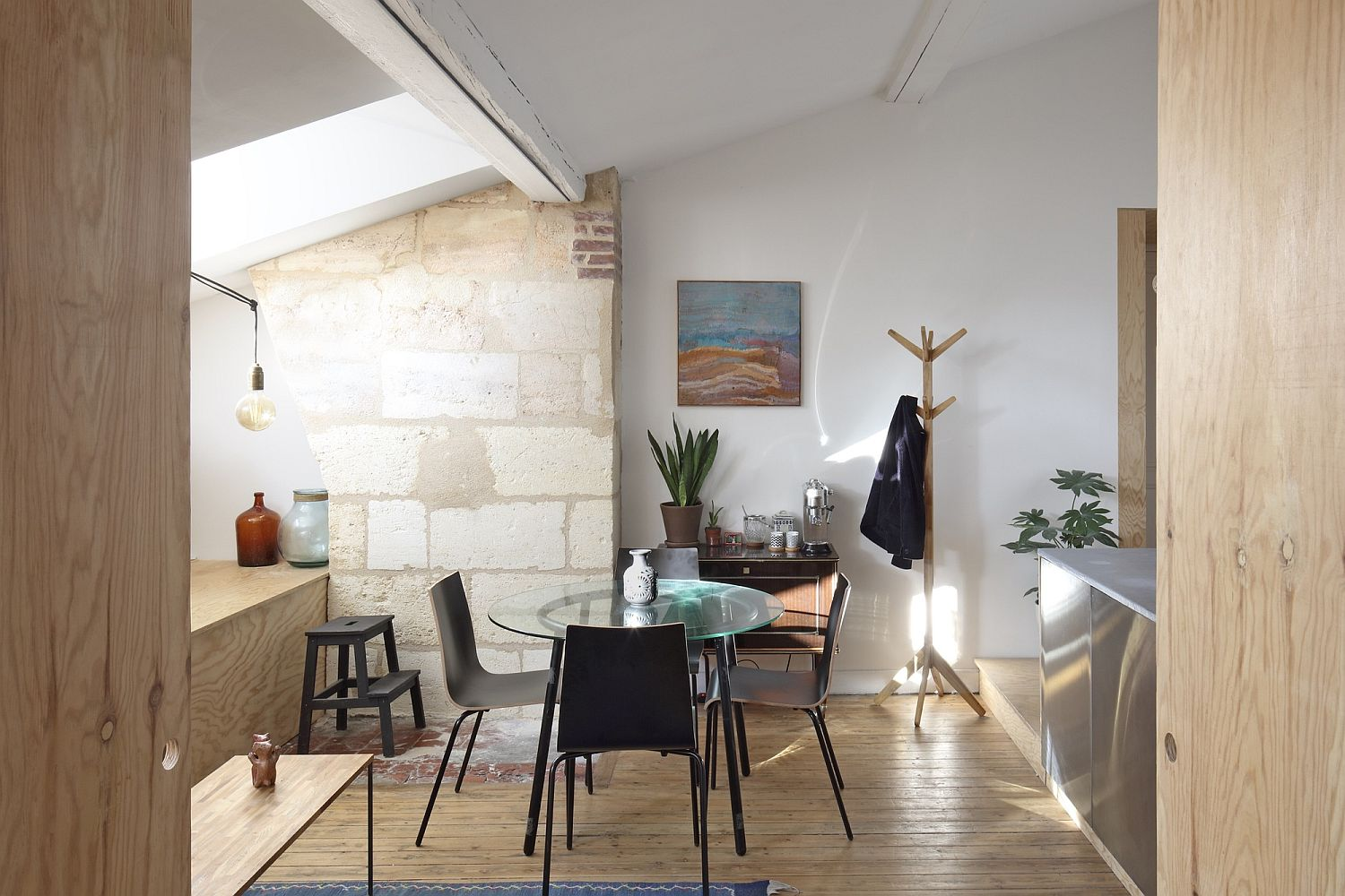 Different textures and finsihes combined in a smart manner inside the tiny French apartment