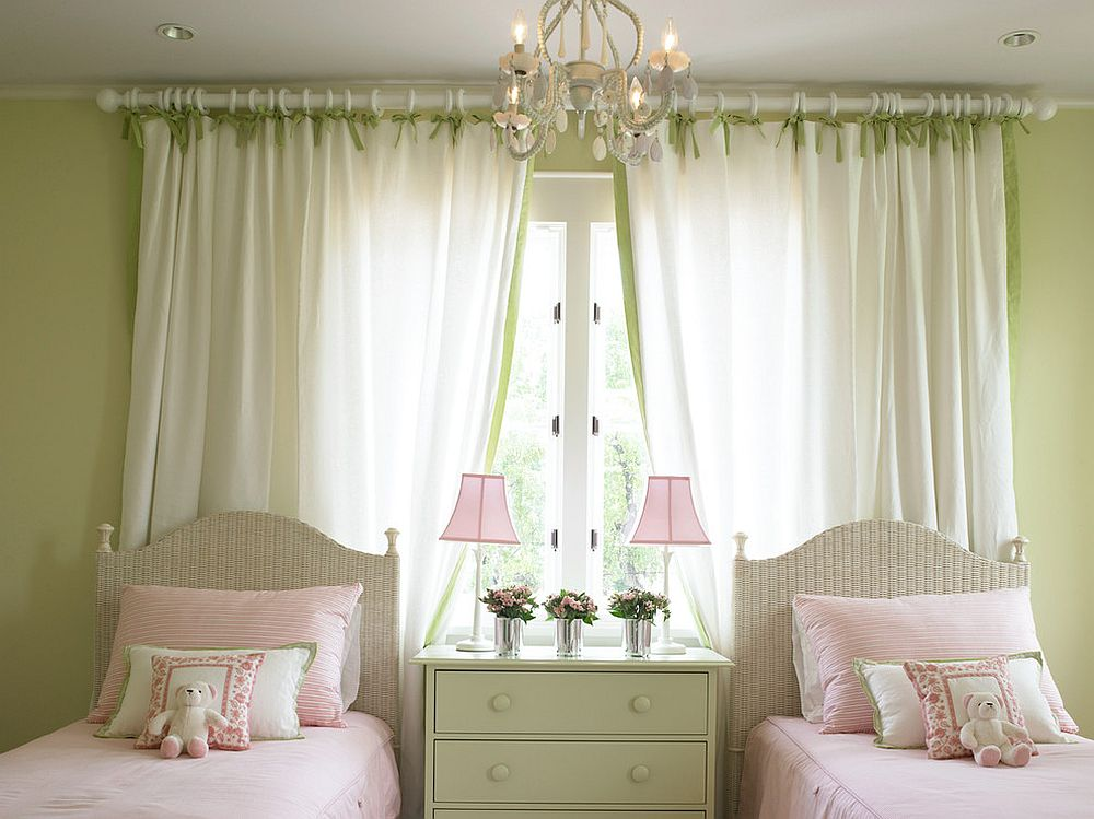 Exquisite kids' bedroom in light green feels relaxing