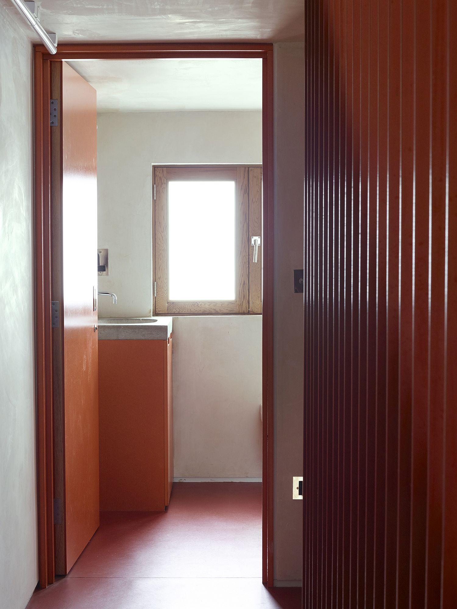 Exquisite use of orange throughout the revamped Gate House