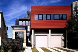 Bright Orange Corrugated Exterior Redefines Eclectic Modern Memphis Home