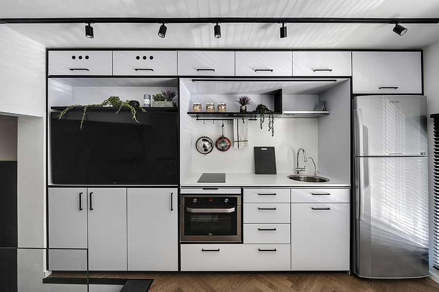 Gorgeous contemporary kitchen with white Formica finish and a black stripe