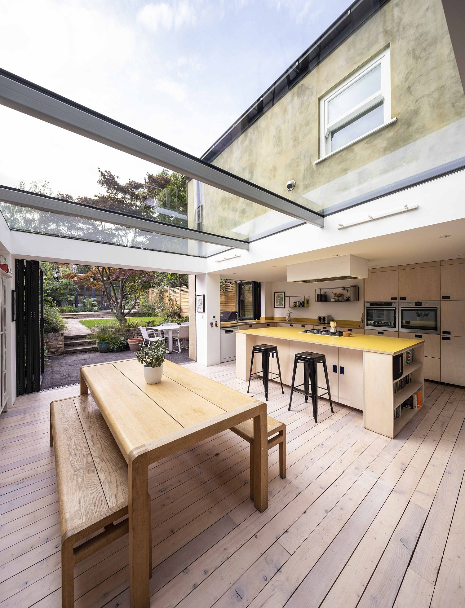 Gorgeous kitchen and dining room of the British home with glass ceiling