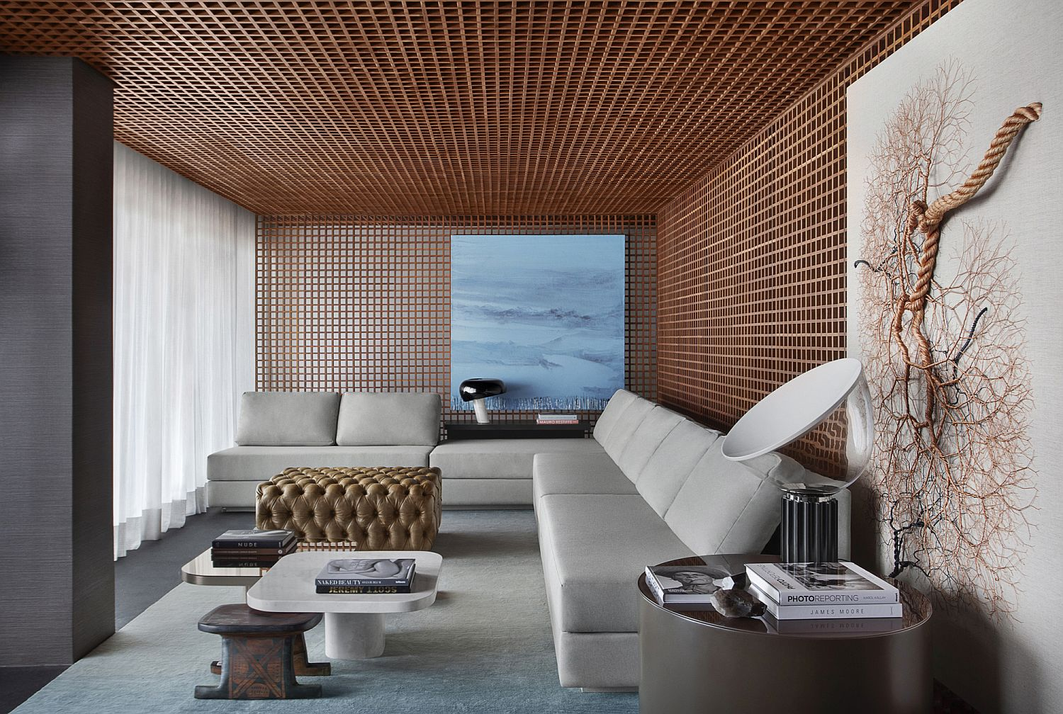 Grid-pattern-on-the-ceiling-and-walls-conceals-several-features-within
