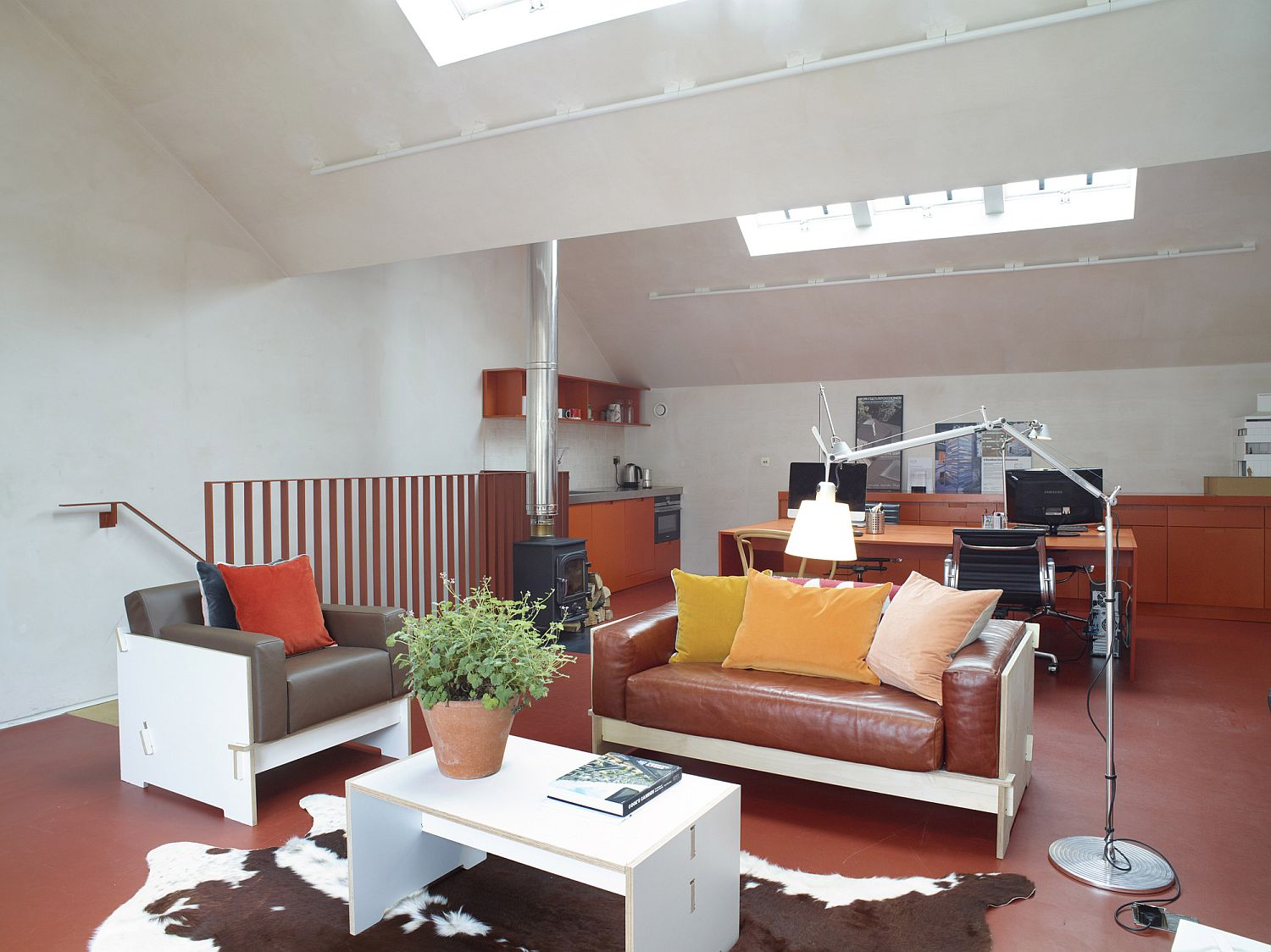 Light-filled living area in bright orange and white