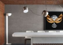 Lighting-adds-brilliance-to-the-dining-space-and-kitchen-in-the-grid-house-217x155