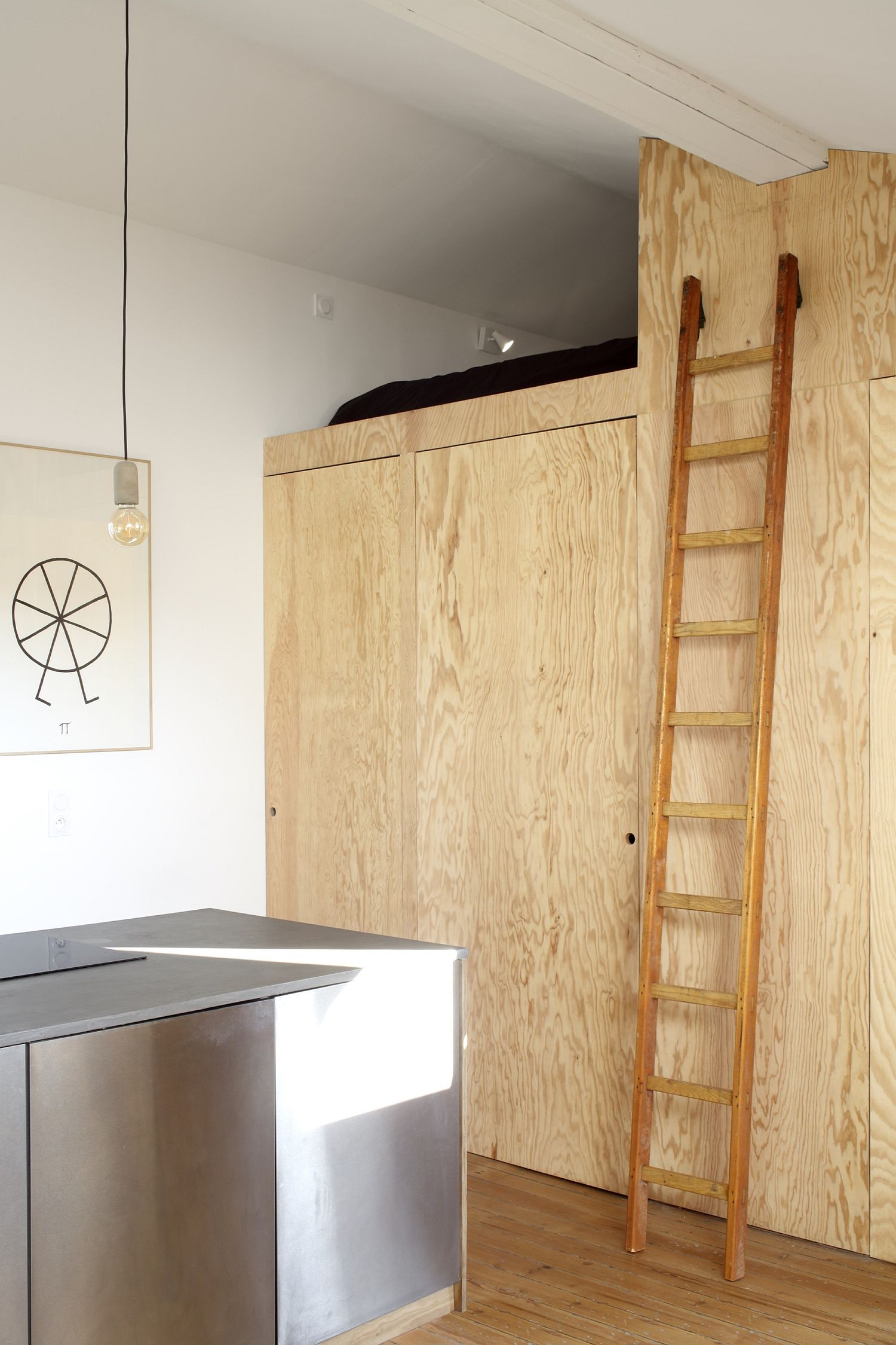 Loft bed level offers additional sleeping space above the bathroom