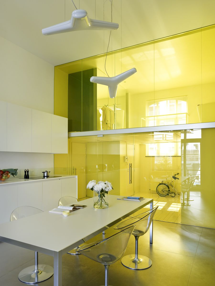 Modern loft inside old school building in Brussels with plenty of yellow