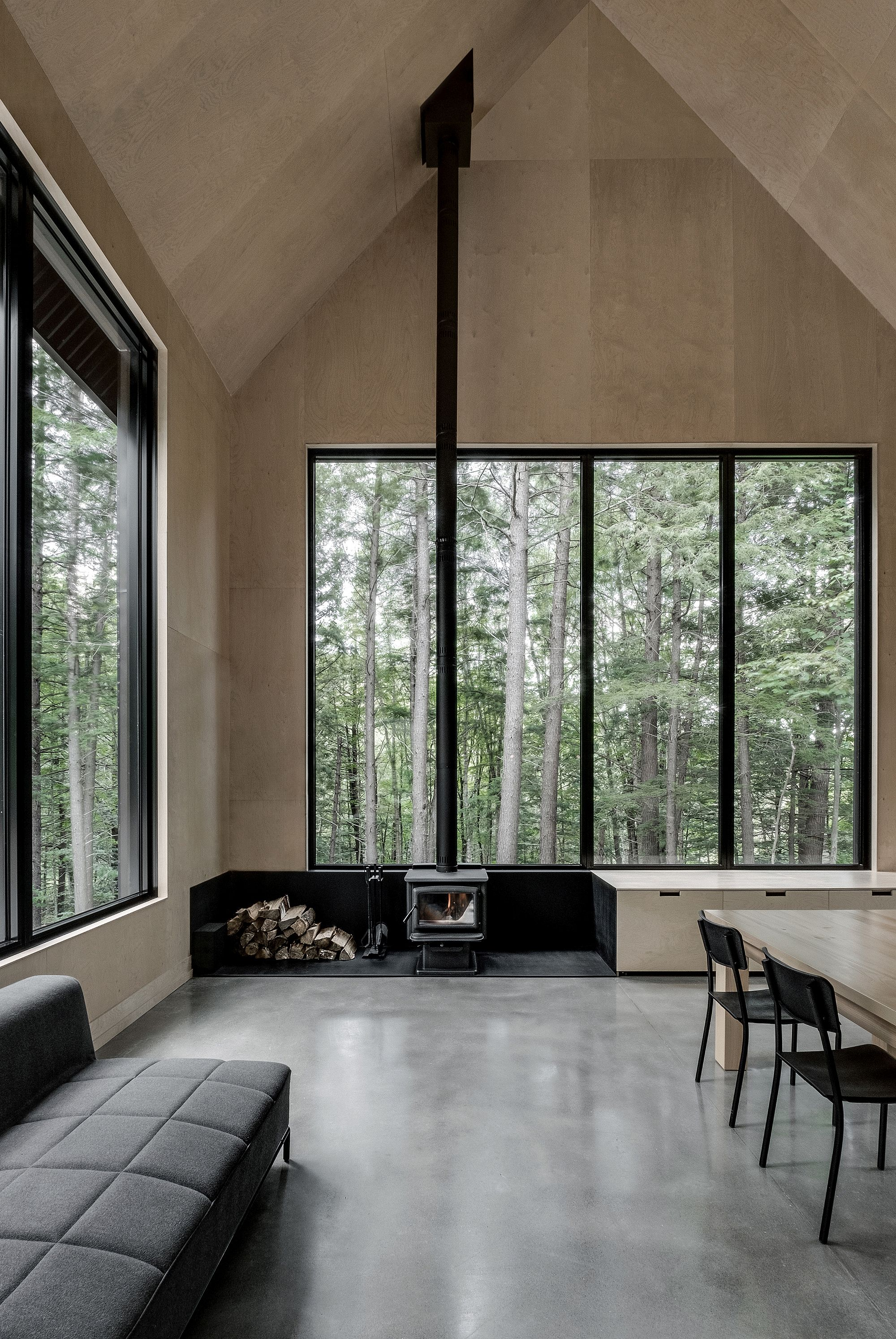 Modern minimal interior of cabin with stunning forest views