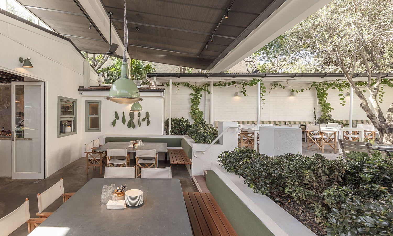 Modern restaurant in Bondi Beach with white and green palette