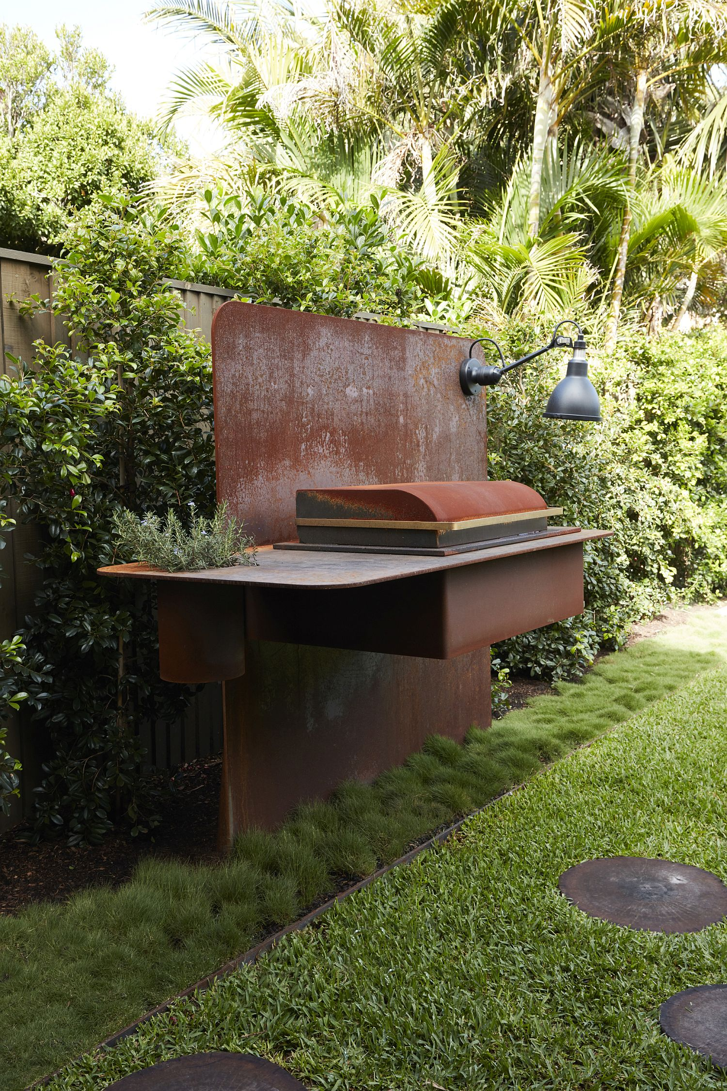 Outdoor barbeucue area with a rusted finsih