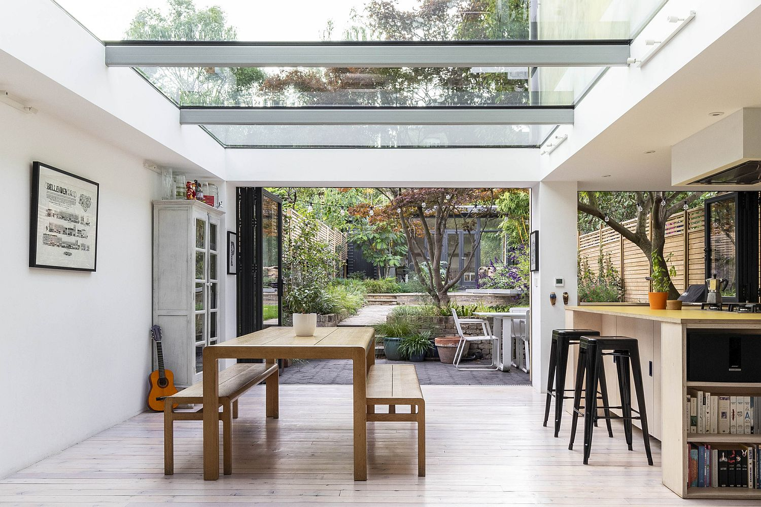 Skylights and glass walls bring light into the renovated home