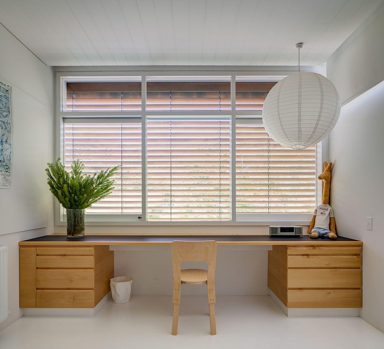 Sleek wooden floating desk for the modern home office in white