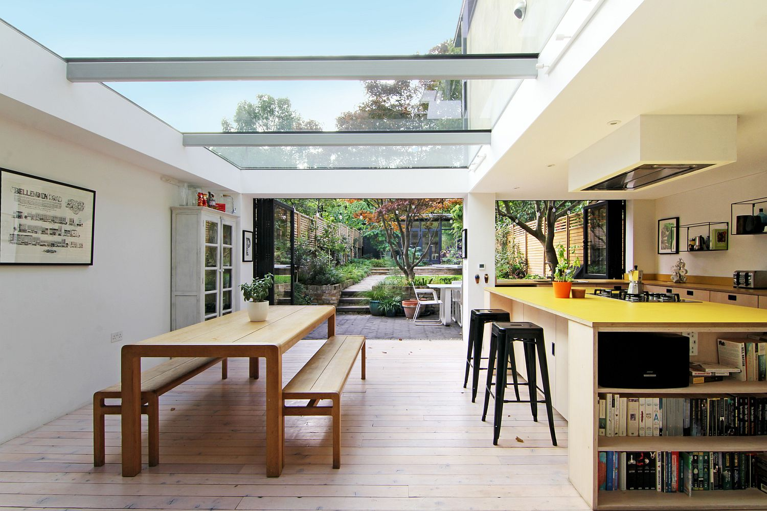 Smart white kitchen and dining space with ample natural light