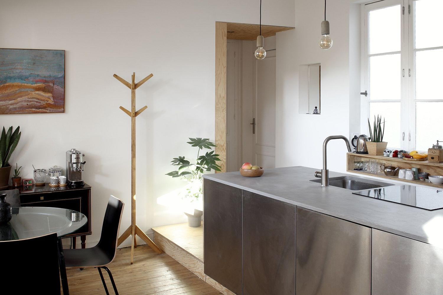 Sparkling stainless steel kitchen island for the small apartment in white