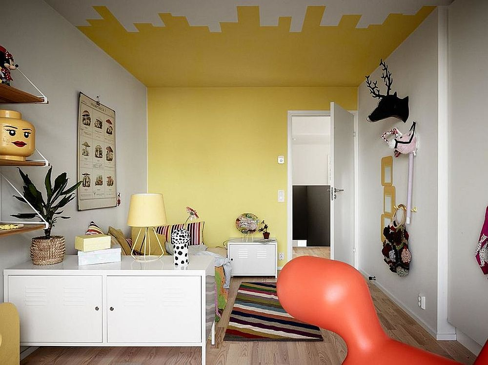 Taking yellow to the ceiling adds another dimension to the kids' bedroom