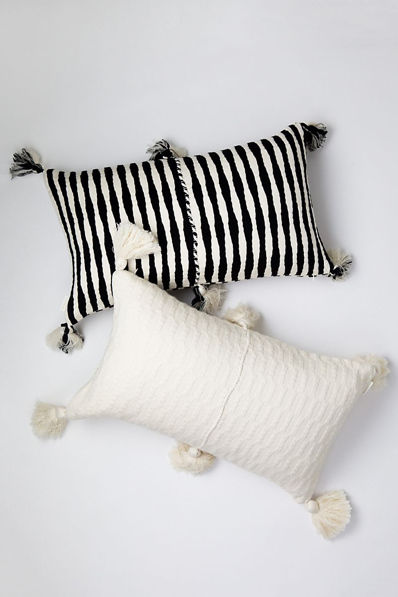 Tasseled pillows with stripes