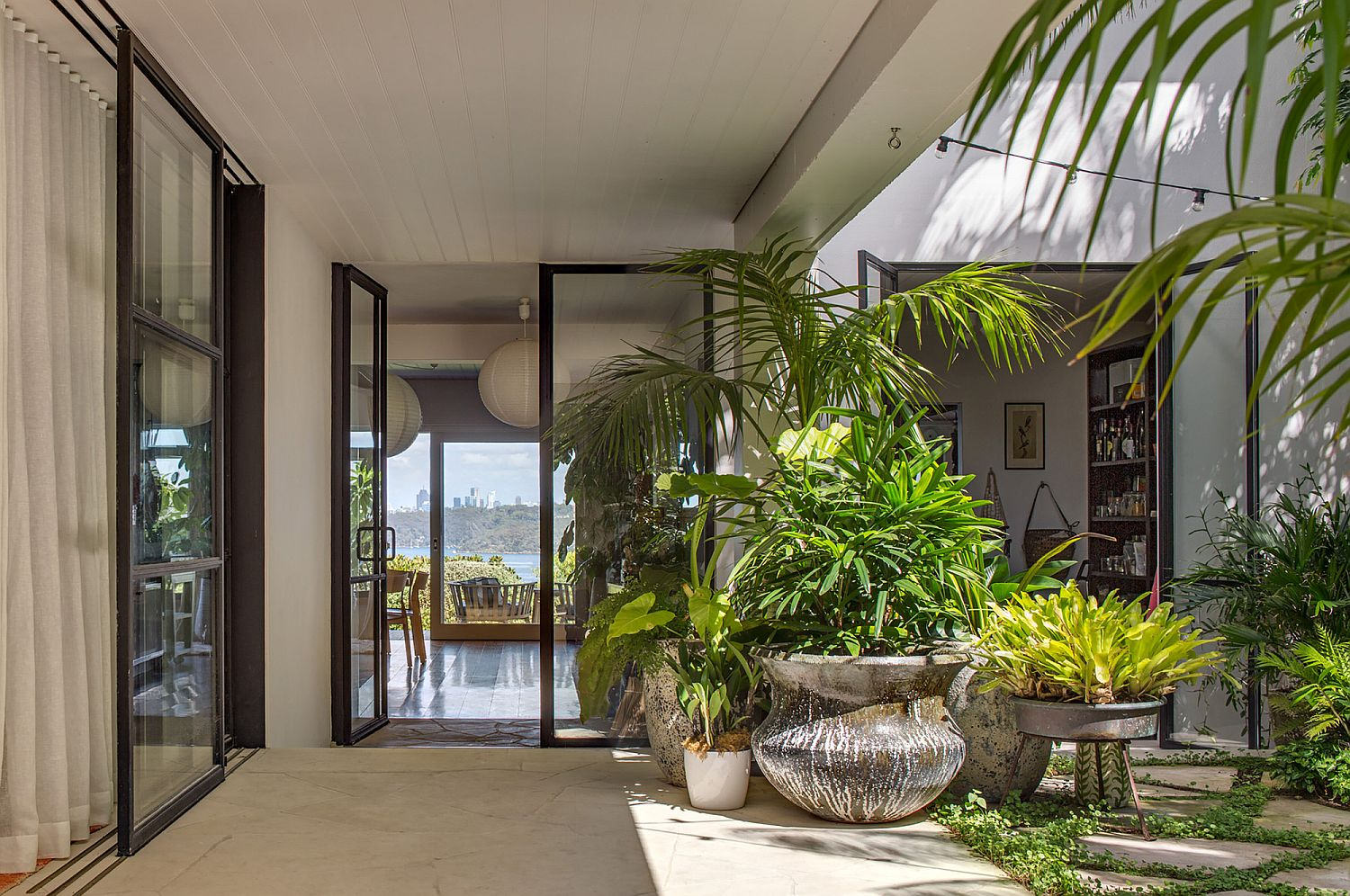 White-and-elegant-outdoor-spaces-with-plenty-of-green-thrown-in