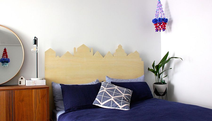Awesome use of plywood to create a headboard that mimics city skyline