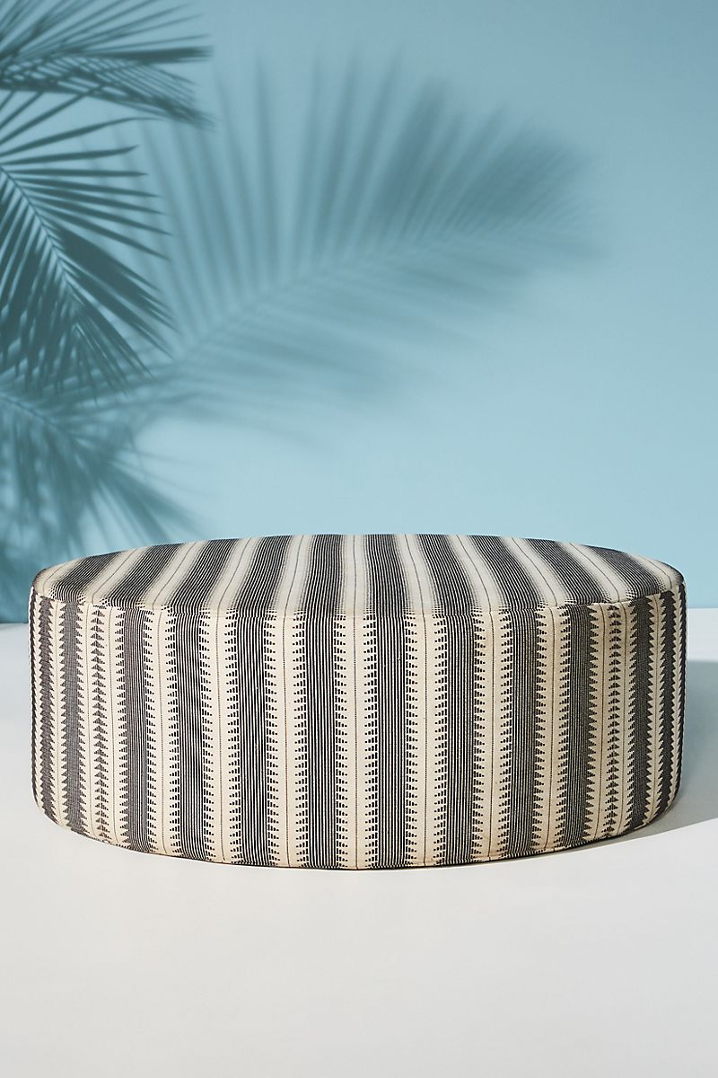Black and white upholstered ottoman