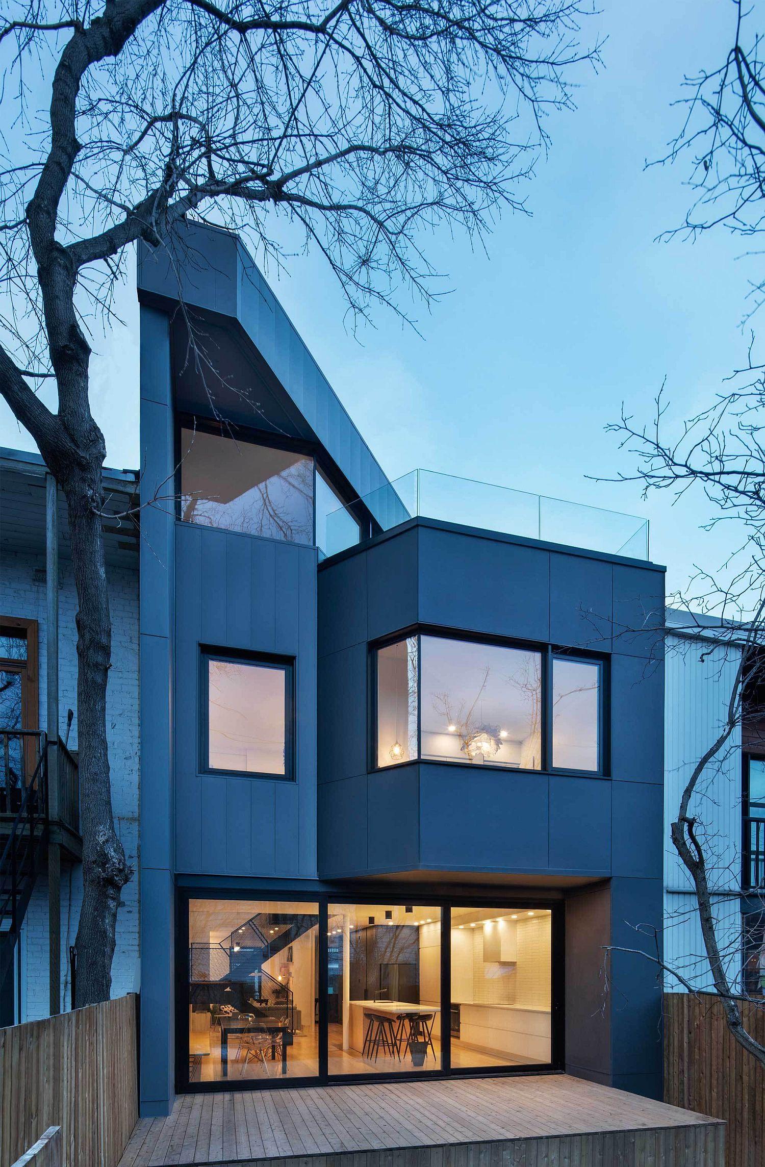 Blue rear facade of the contemporary residence in Canada
