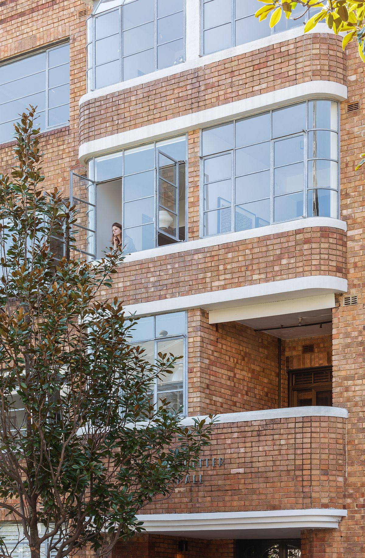 Brick exterior of the building that holds the small Sydney apartment