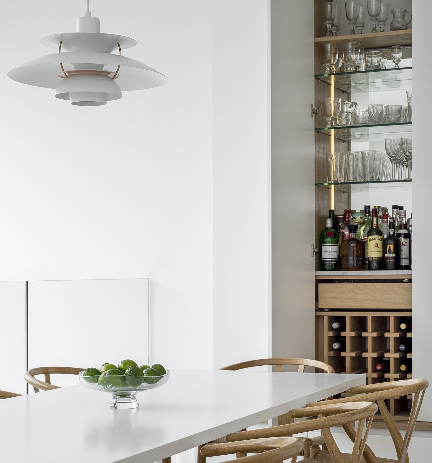 Combining the home bar setting with the dining space