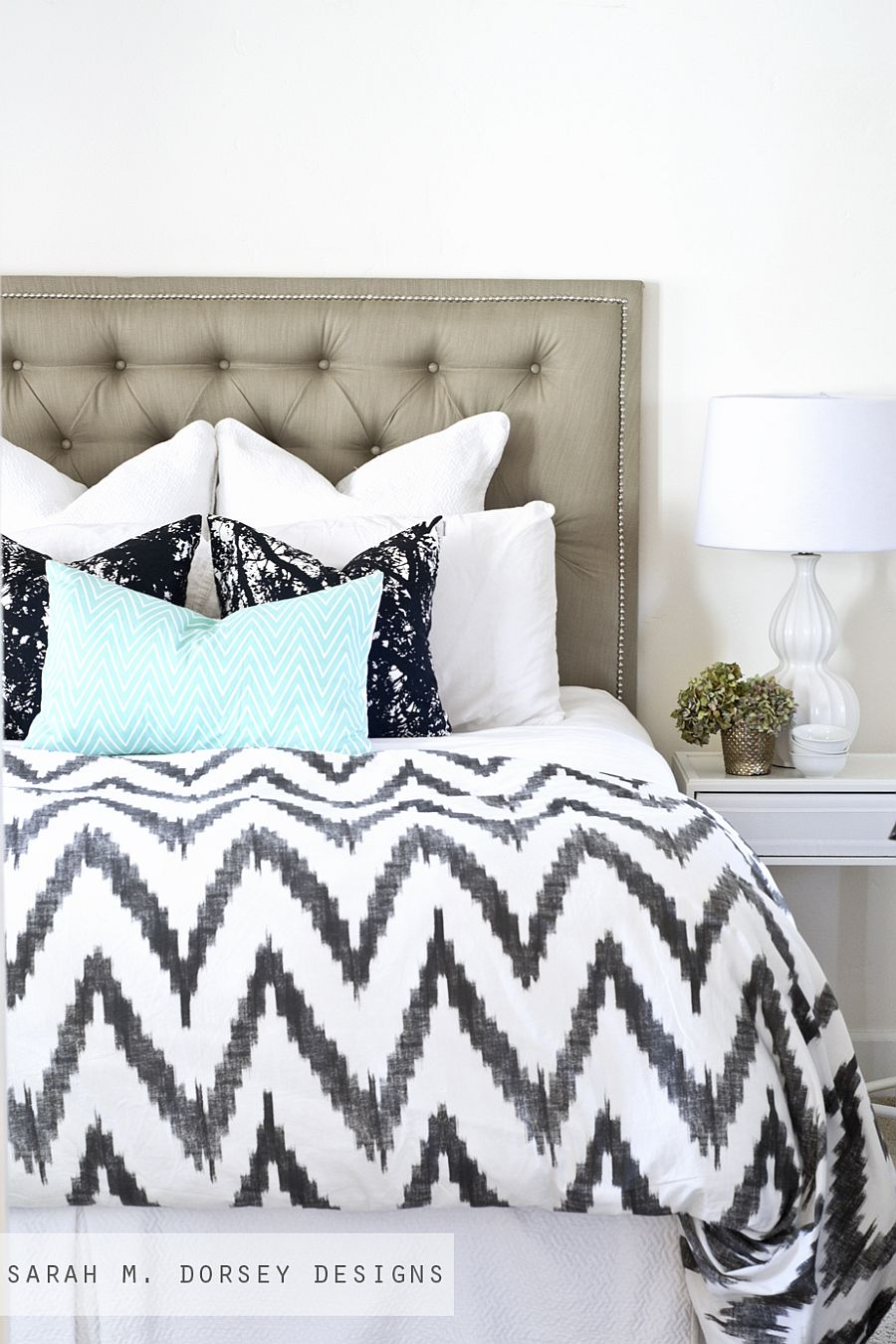 Contemporary DIY tufted headboard in chic gray is a showstopper in an understated fashion