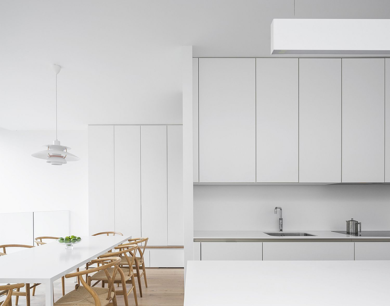 Contemporary kitchen and dining area in white with monochromatic charm