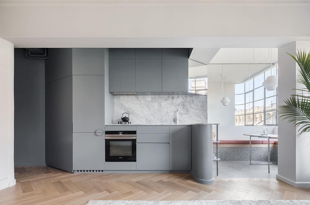 Contemporary kitchen in gray with wooden flooring for the tiny urban apartment