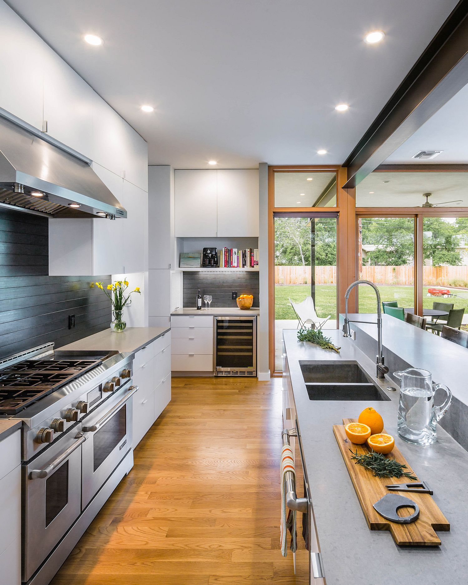Contemporary kitchen with multiple islands and flooring in wood