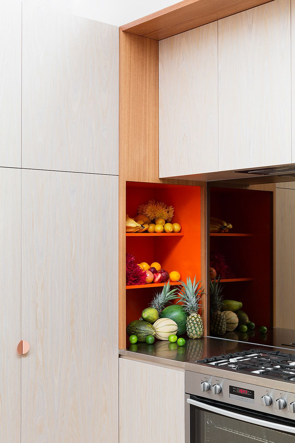 Creative use of orange as accent hue in the kitchen