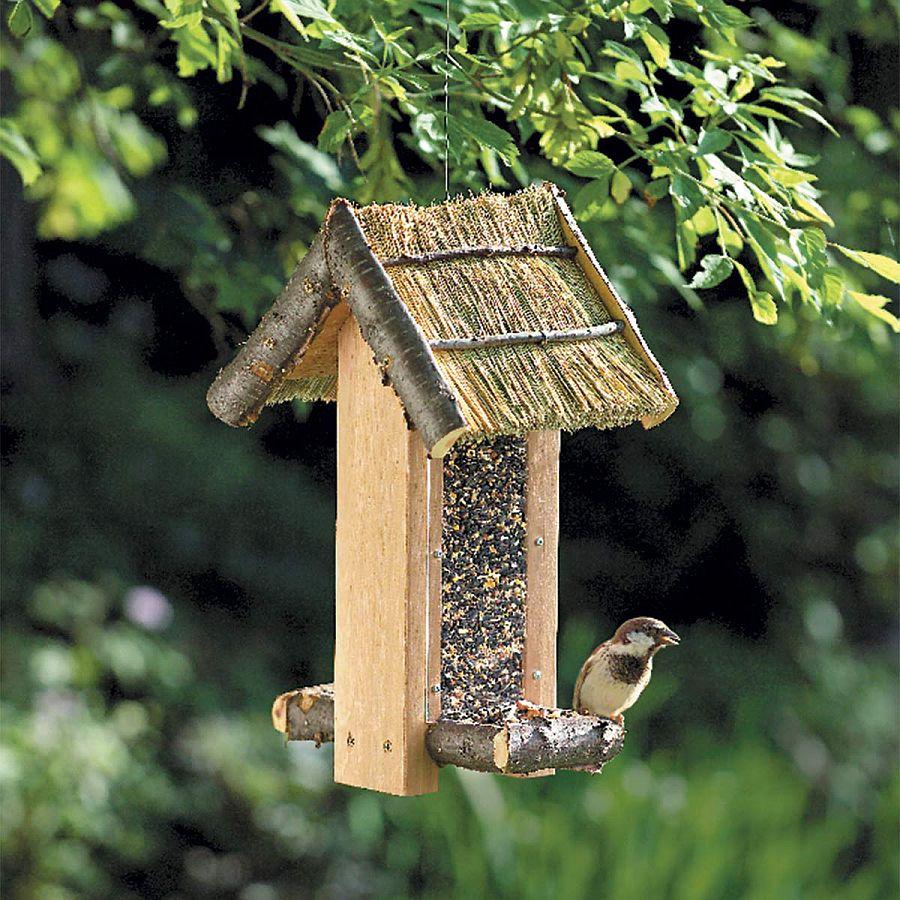 Custom-DIY-bird-feeder-full-of-rustic-charm