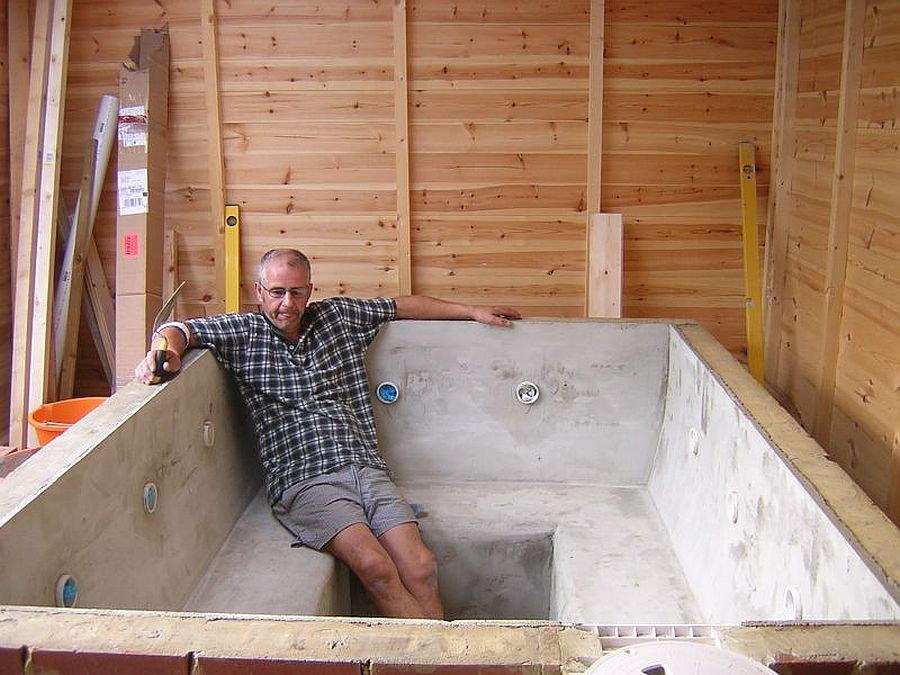 Custom relaxing concrete hot tub will last you a while!