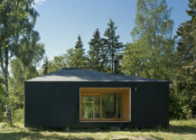 Dark-exterior-of-the-small-summer-house-in-woods-allows-it-to-blend-in-with-the-backdrop-217x155